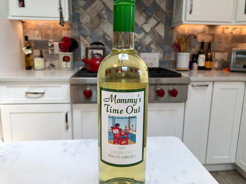 A bottle of wine on the counter