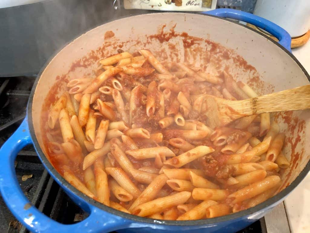 Penne and tomato sauce in a pot