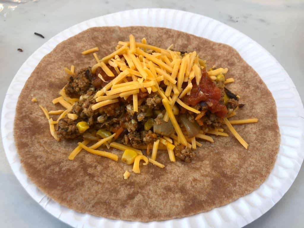 Meat mixture with cheese in a tortilla