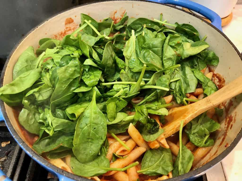 Spinach and pasta in a pot
