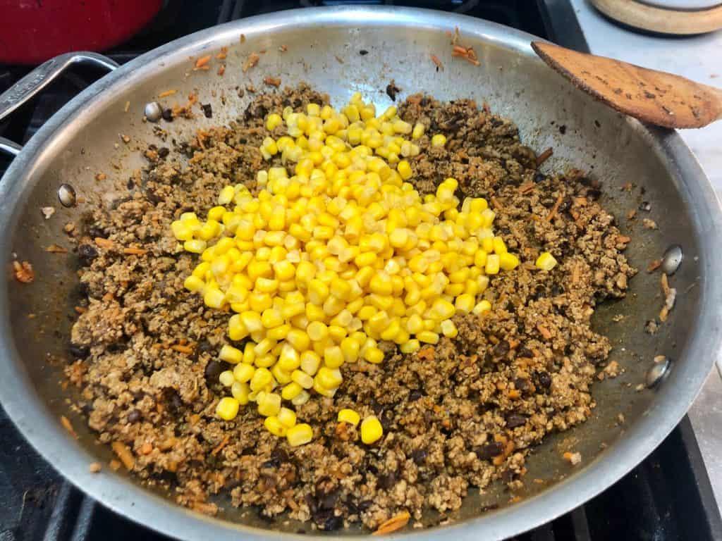 Corn added to seasoned meat