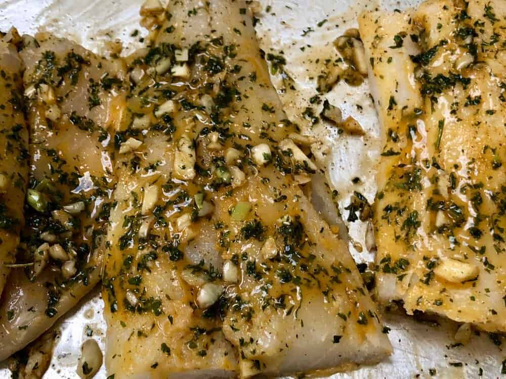 Cod marinating on a pan