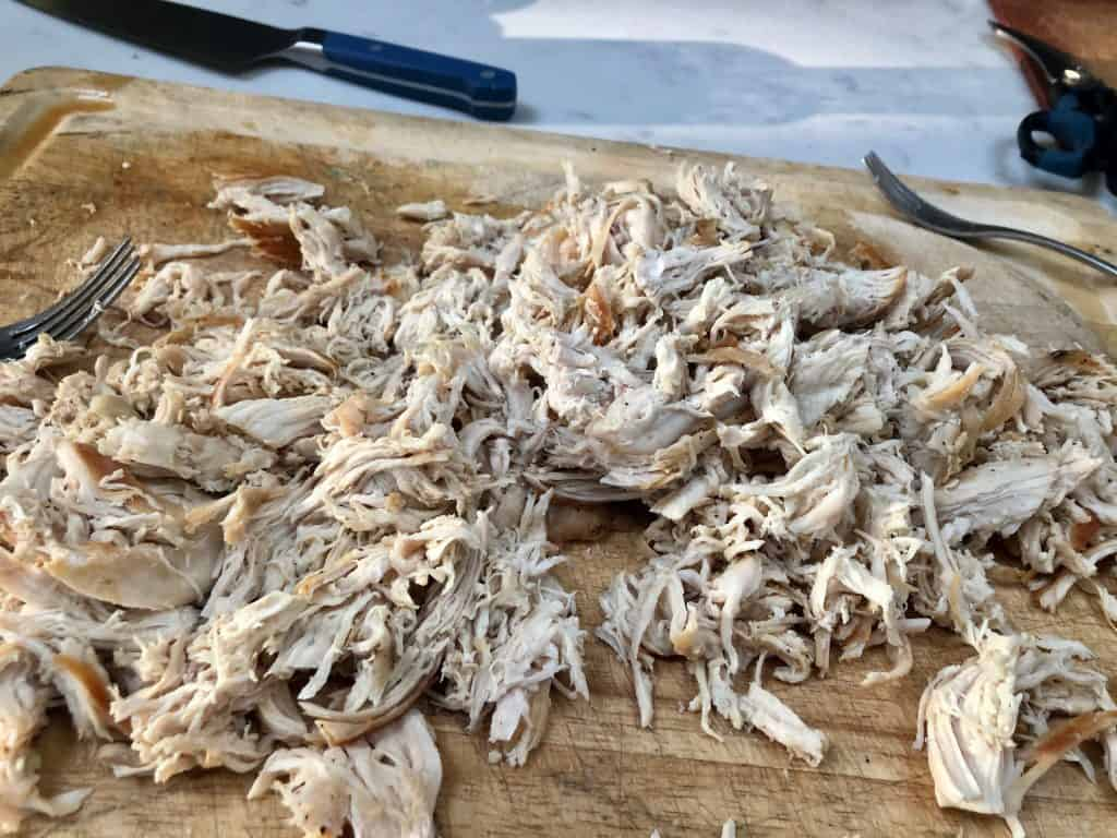 Shredded chicken on a cutting board