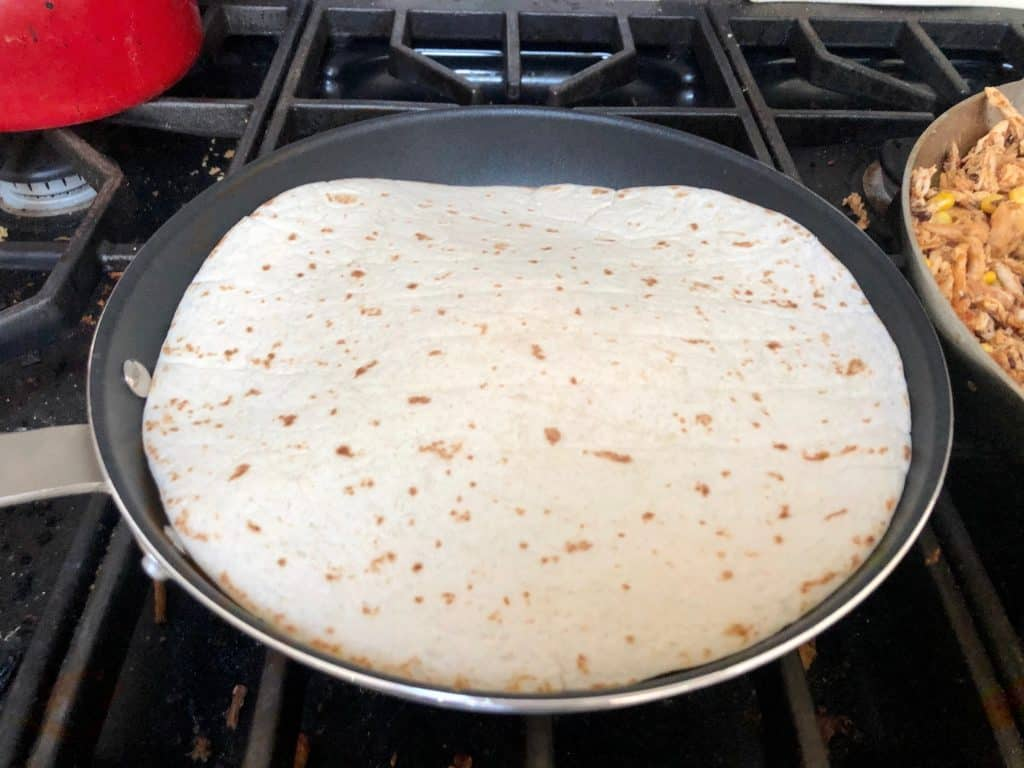 Quesadilla cooking in a pan
