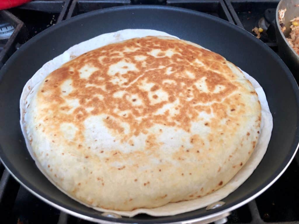Cooked quesadilla in a pan