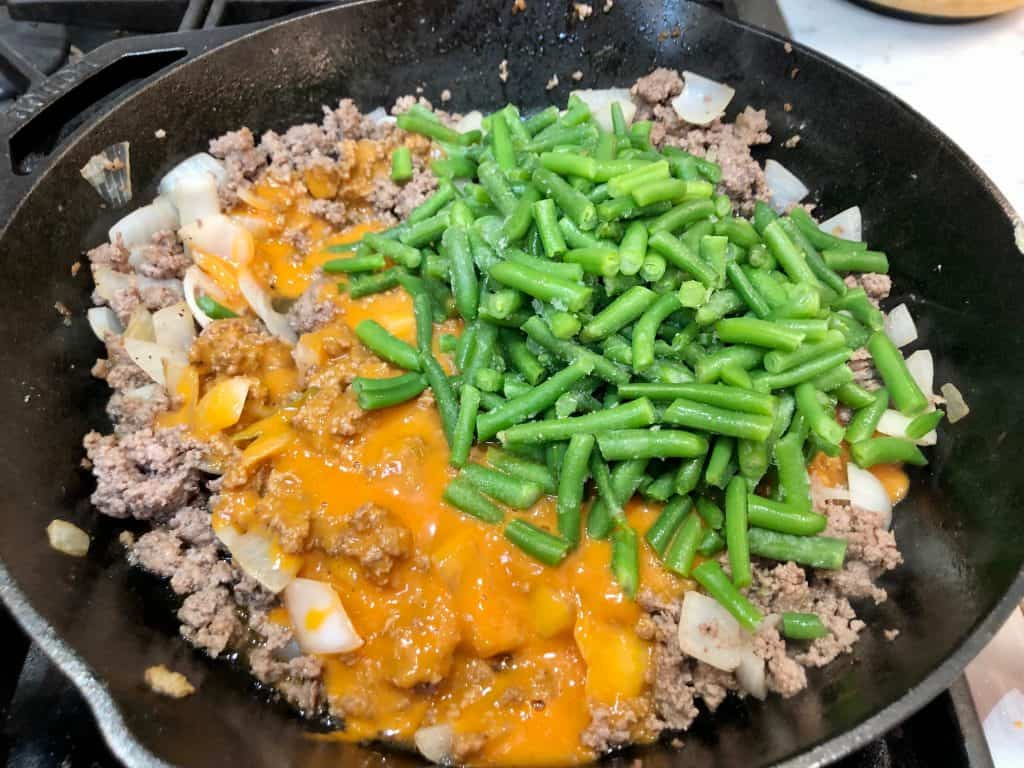 Green beans, soup and ground beef in a skillet