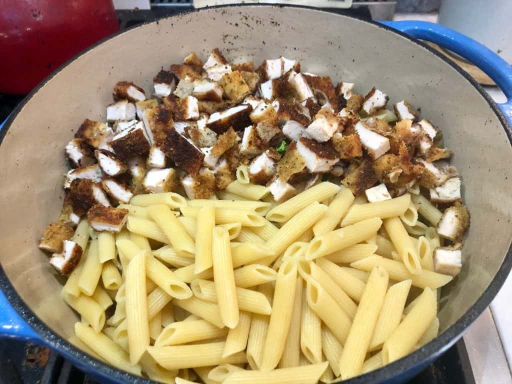 Penne with breaded chicken cutlets in a pot