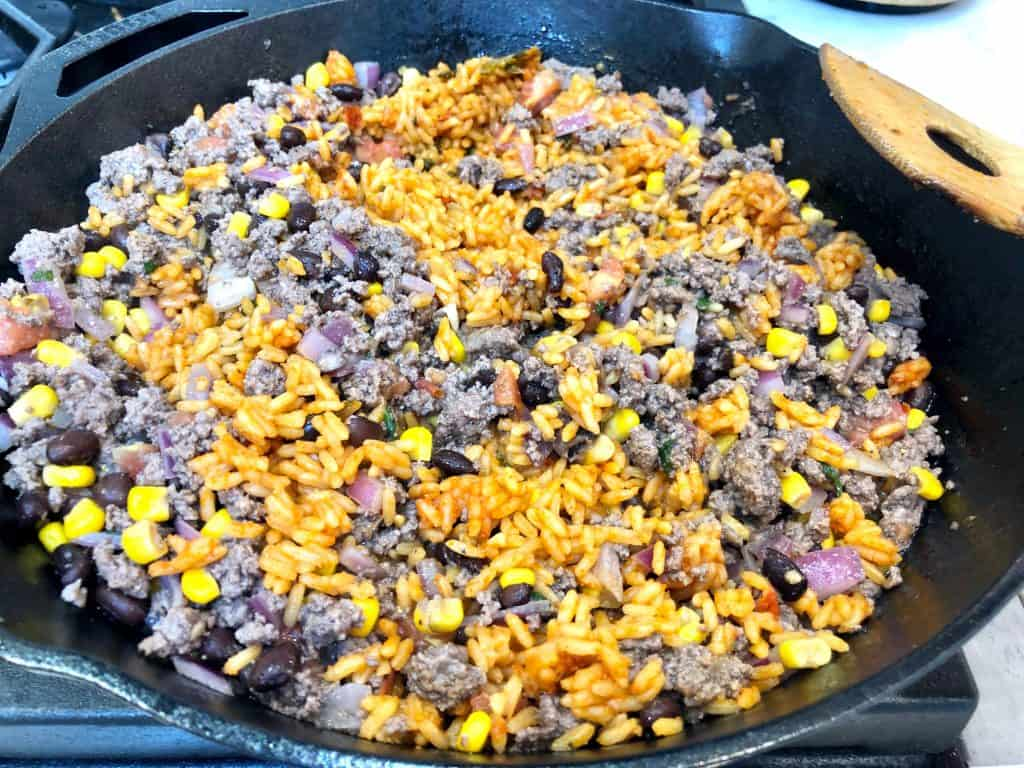 Spanish rice with ground beef in skillet