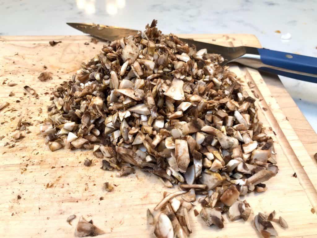 Chopped mushrooms on a cutting board