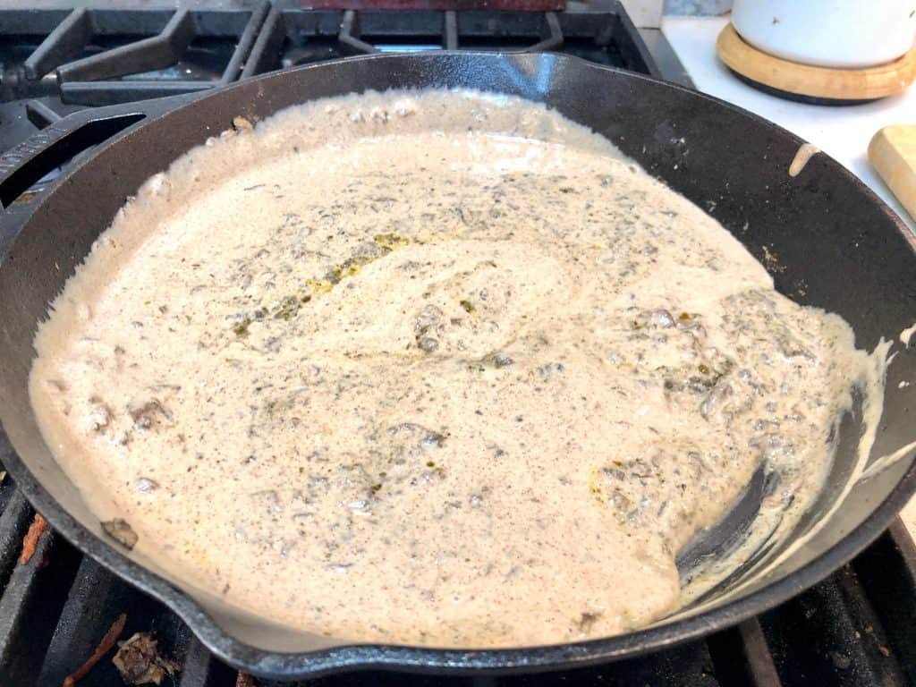 Almond butter and almond milk sauce in a skillet