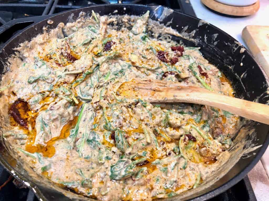 Creamy almond sauce in a skillet