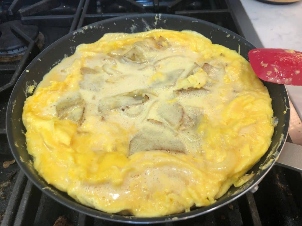 Egg frittata cooking in a pan