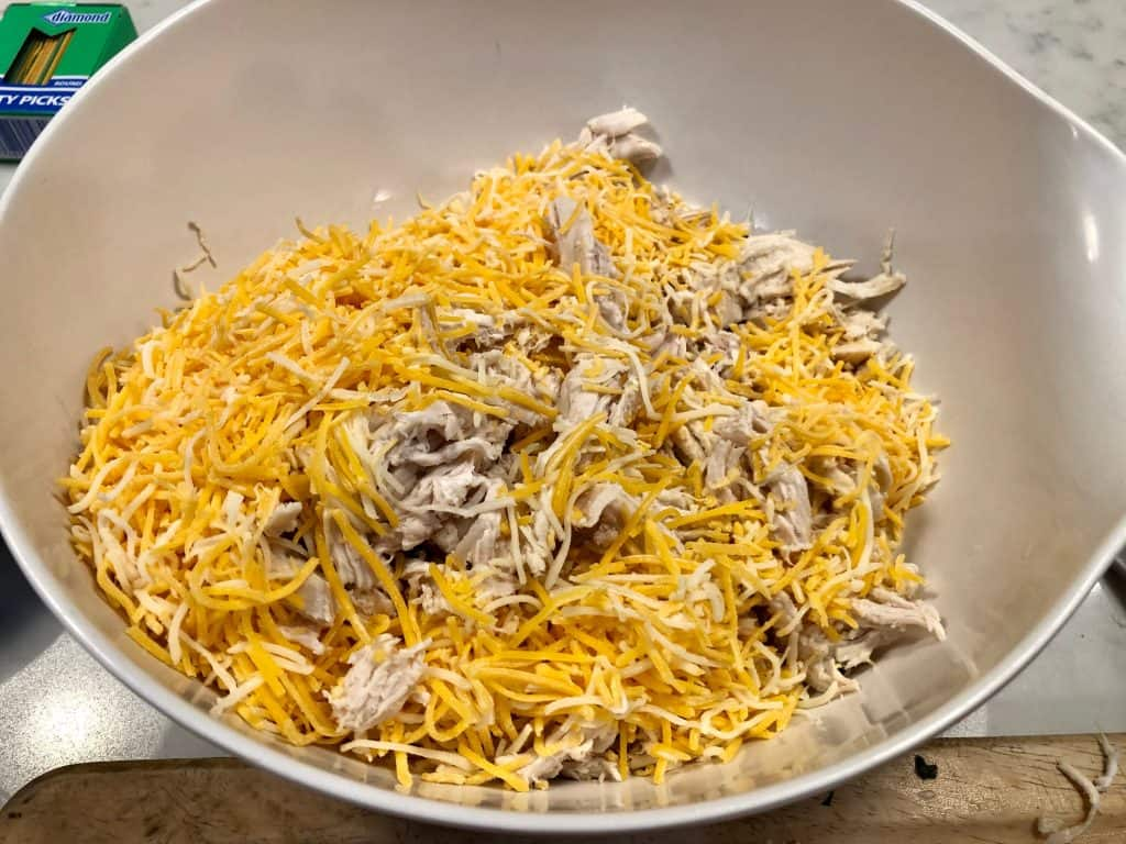 Shredded chicken and cheese in a bowl