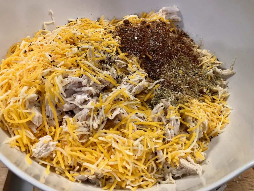 Shredded chicken with cheese and seasoning