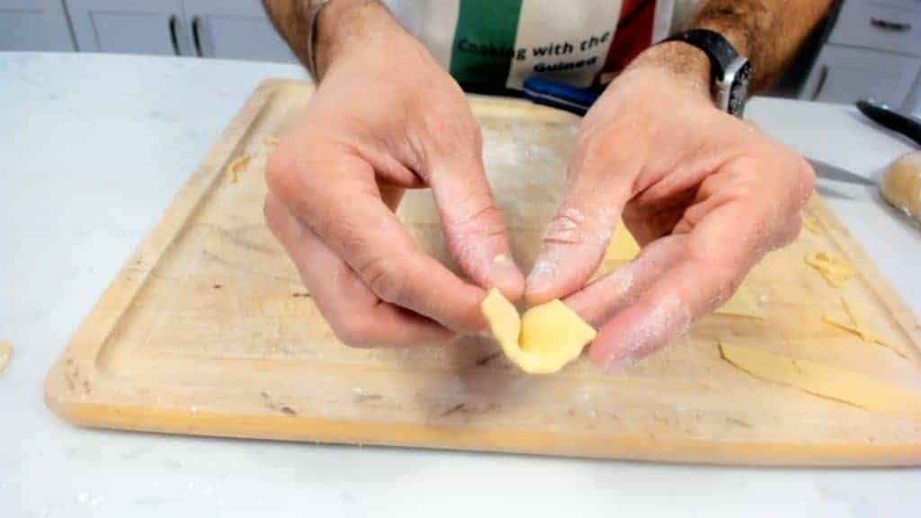 Folding homemade farfalle