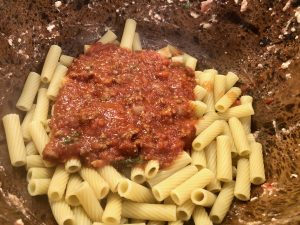 Rigatoni with sauce in a bowl