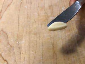 Rolling pasta dough with a knife