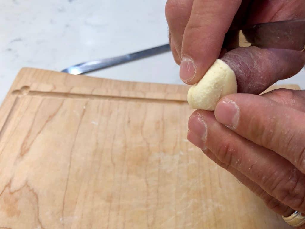 Forming dough into homemade Orecchiette