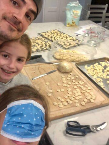 Family making homemade orecchiette