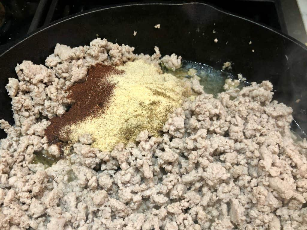 Seasoning added to browned meat