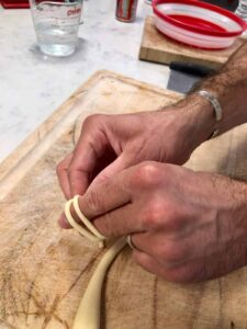 wrapping pasta dough around fingers