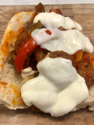 Sausage and peppers sandwich with mozzarella