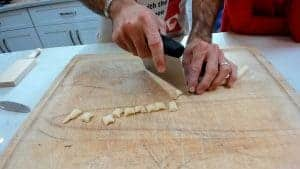 Cutting small pieces of pasta dough