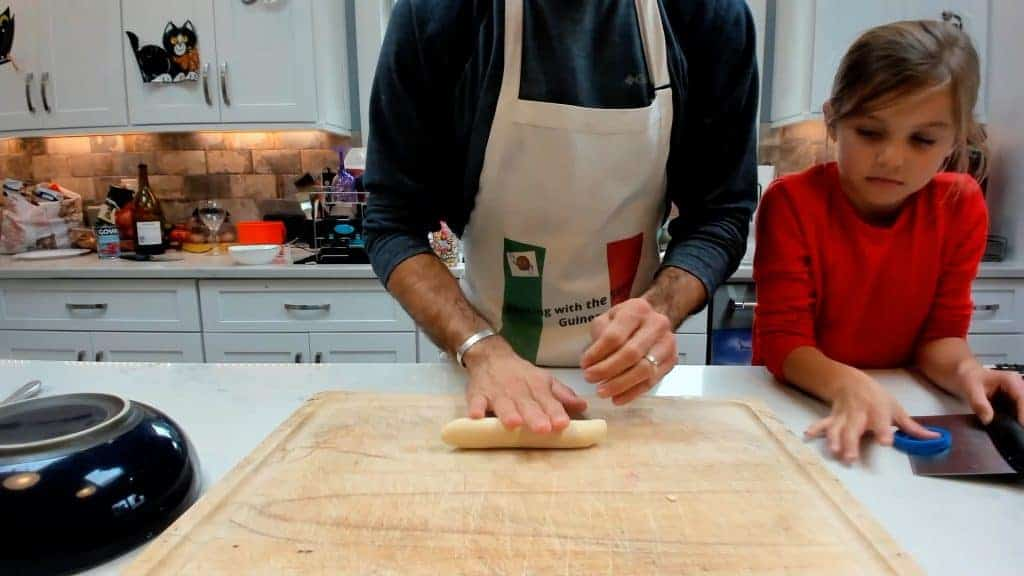 Rolling homemade dough into a rope