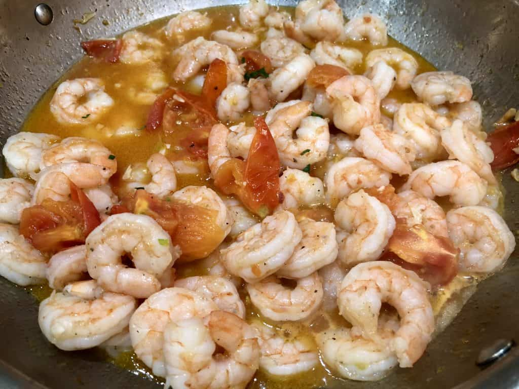 Shrimp cooking with tomatoes
