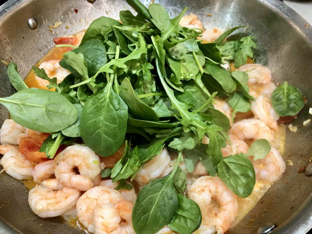 Spinach and shrimp cooking