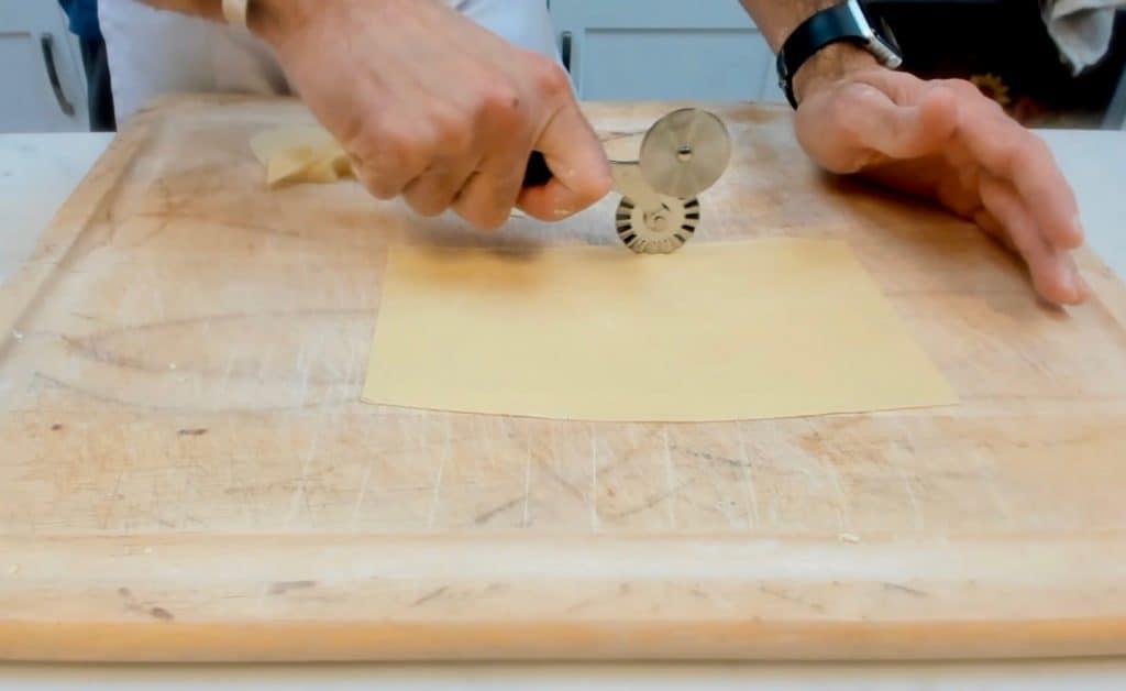 Cutting homemade lasagna pasta
