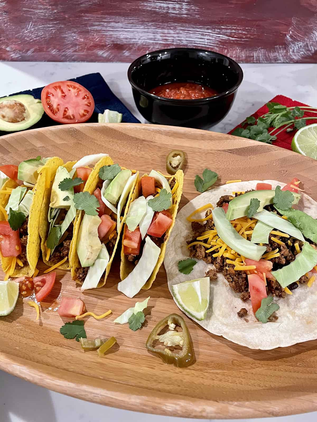 tacos spread out on a serving tray