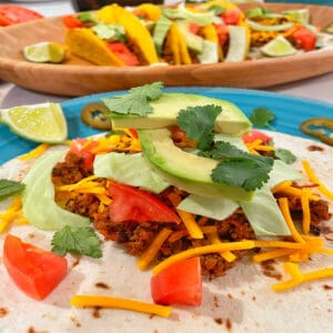 a soft taco piled high with fillings
