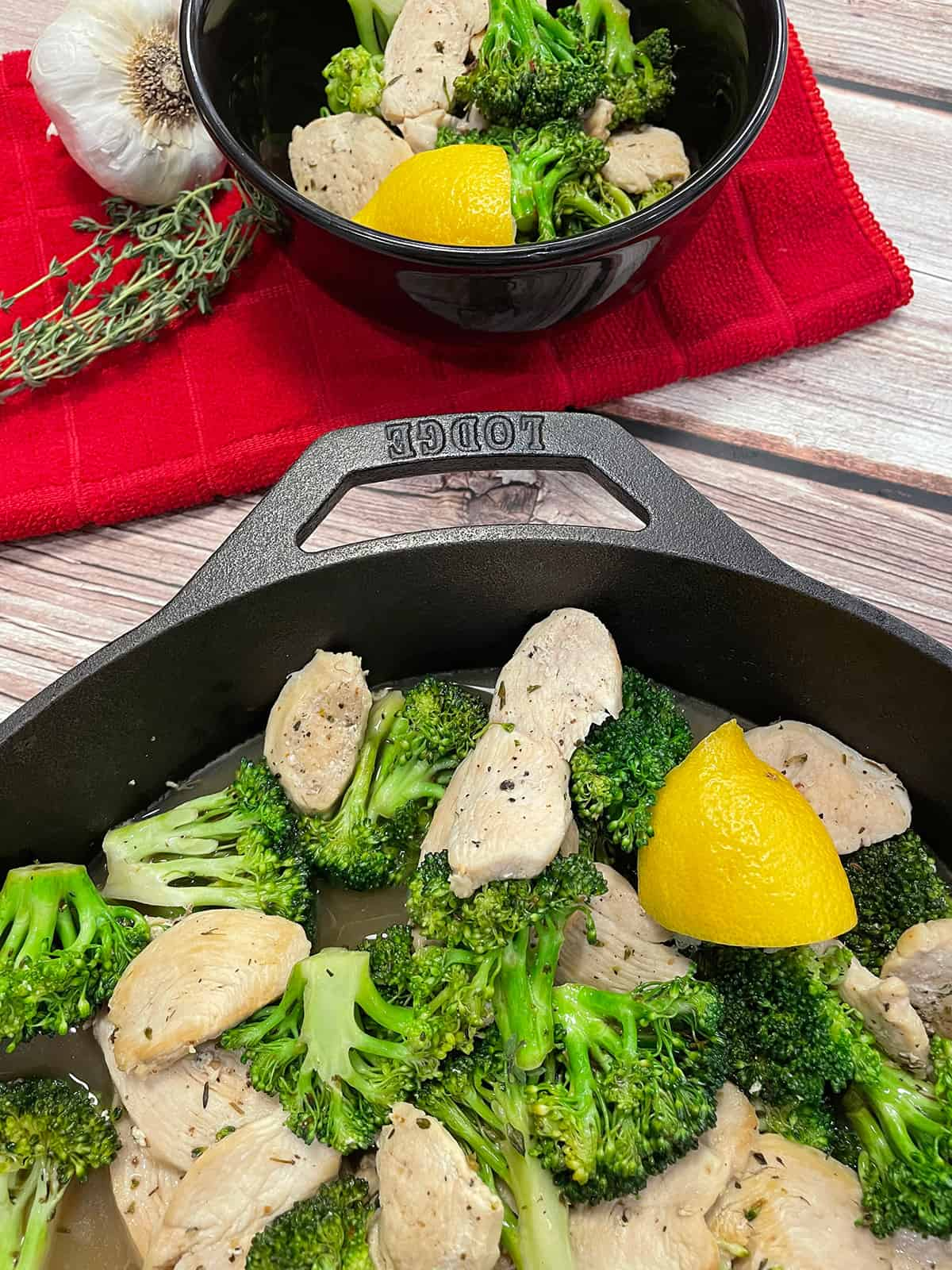 healthy lemon garlic chicken in bowl and skillet